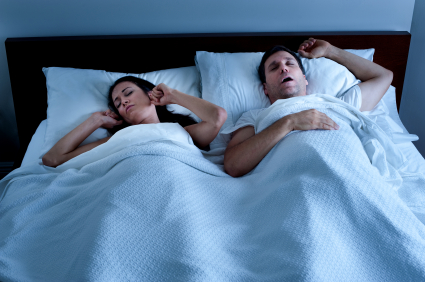 couple sleeping in bed sleep apnea snoring